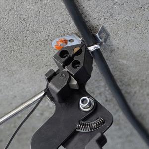 Torsioning tool with metal tie mount